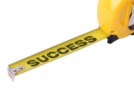 Concept of measuring success on a tape measure isolated on a white background