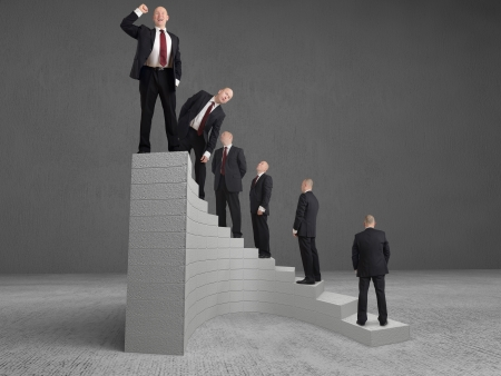 self improvement: concept Businessman reaching the top Stock Photo