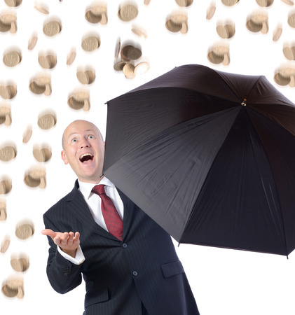 getting better: Man in suit with umbrella concept of getting better raning money