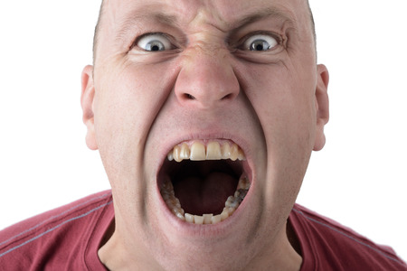 amok:  Facial Expression shouting screaming man isolated on a white background