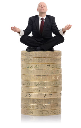 Financial Advisor sat on a stack of money photo