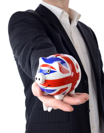 a businessman offering a piggybank isolated on a white background photo