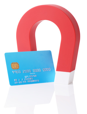A magnet erasing a credit card strip isolated on a white background