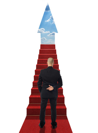concept for steps of career a man crossing his fingers at the bottom of the steps photo