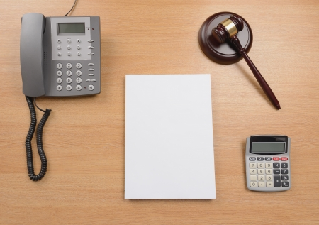 solicitor: A desk of a judge or lawyer or solicitor with a blank document for copy space