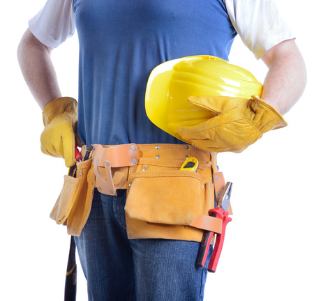 handy man with tool belt ready for work isolated on a white background