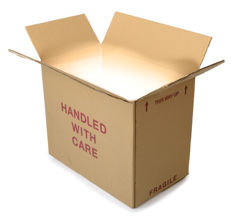 A brown cardboard box open  with light comming from out the box and isolated on a white background photo