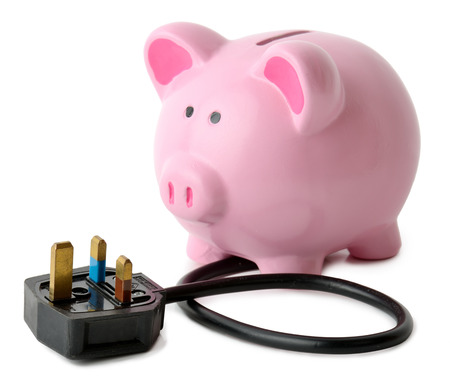 rebates: concept of saving energy a piggy bank with a plug isolated on a white background Stock Photo