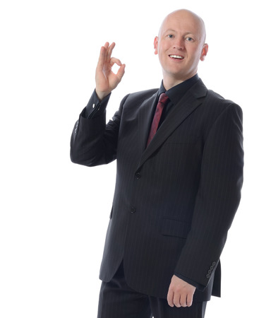 Man is suit gesturing the ok sign isolated on a white background Stock Photo - 26702512