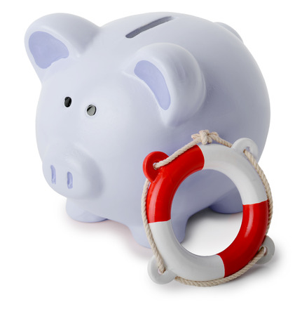 life saving: life saving in a piggy bank isolated on a white background