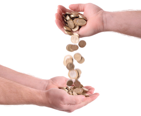 money falling: giving and receiving money falling from one hand to another isolated on a white background  Stock Photo