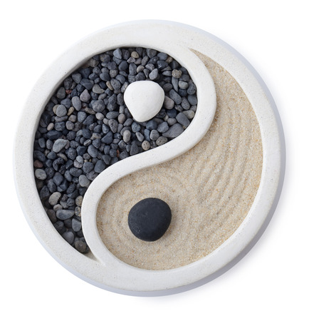 a small zen garden ying yang symbol isolated on white photo