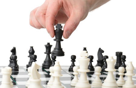 playing chess: Making a strategic move isolated on a white background Stock Photo