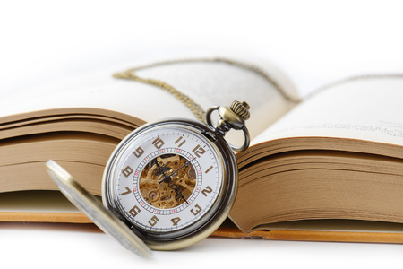 old pocket watch on a open book  photo