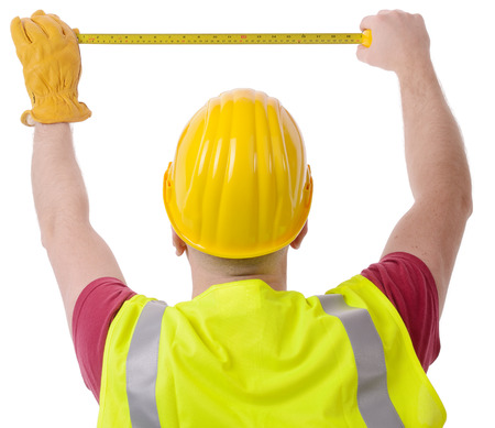 construction worker measuring with tape isolated on a white Stock Photo - 28428046