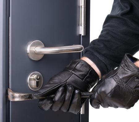 Irrumpiendo en una puerta de acero Foto de archivo - 28428051
