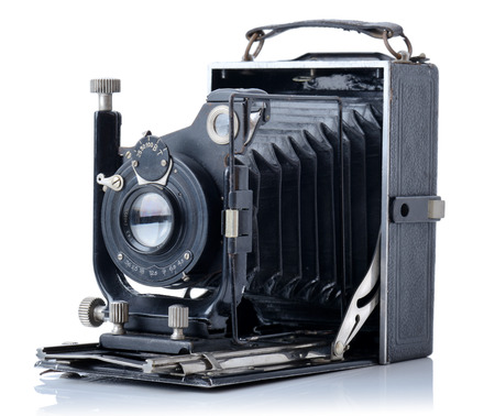 folding camera: on old vintage camera from 1928 isolated on a white background