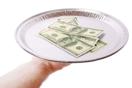 serving up money on a plate isolated on a white background photo