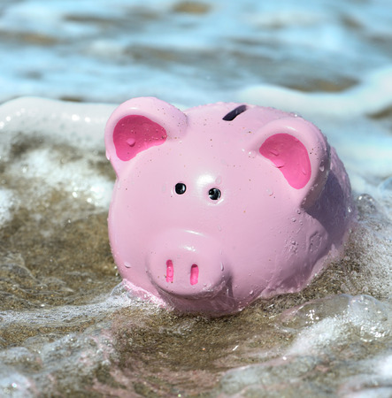 engulfed: piggy bank engulfed by water