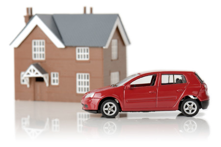 a red car and house isolated on a white background photo