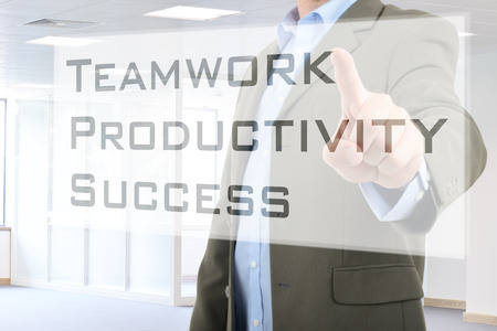 businessman pressing teamwork button on virtual screen photo