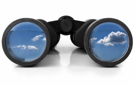 white background: The sky reflected in a pair of new binoculars