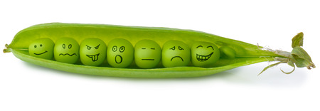 Close-Up of Fresh Green Peas in a Pod  with emontions on each one  isolated on a white background photo