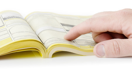 yellow pages: yellow pages searching with finger, blank spaces for text input. all information burred