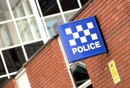 scene of a crime: A Police Station Sign  Stock Photo