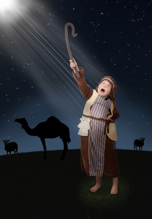 young shepherd seeing the light of the guiding star photo