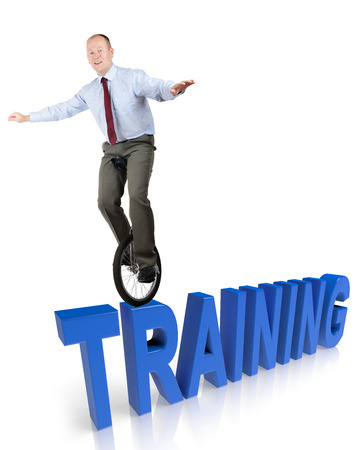A businessman in a unicycle demonstrating skill in training photo