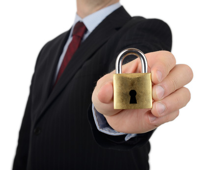 social security: A man in a suit holding to camera a padlock a concept of security Stock Photo
