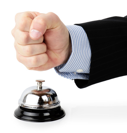 impatient: Concept of a customer complaint hitting a service bell in an angry gesture isolated on a white background