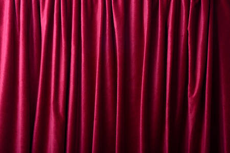 Deep red curtains as a background or texture