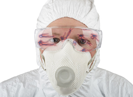 Doctor in protective suite looking at ebola isolated on a white background photo