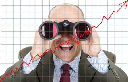 the future growth: Man in suit looking at future growth of sock profit through binoculars Stock Photo
