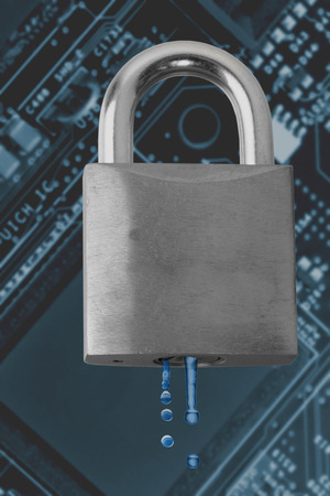 Concept of a security leak, water dripping out from a padlock over a circuit board photo