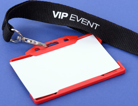 an id badge for a VIP event on a blue background, focuse on the vip text Stock Photo
