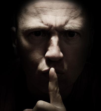 Concept of don't tell anyone! a dark secret Standard-Bild