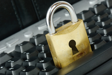 Padlock on a keyboard for a concept of security on the internet photo
