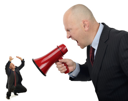 Businessman shouting orders at a worker isolated on a white background photo