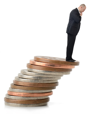 fiscal cliff: A businessman looking over the fiscal cliff.
