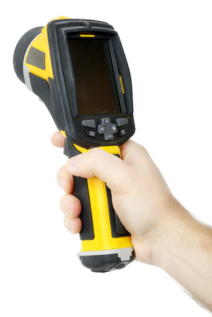 thermal imaging: Holding a thermal imaging camera isolated over a white background