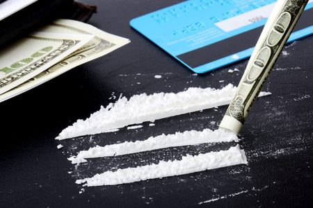 drug use: Sceen of drug use, lines of cocaine with credit card and money