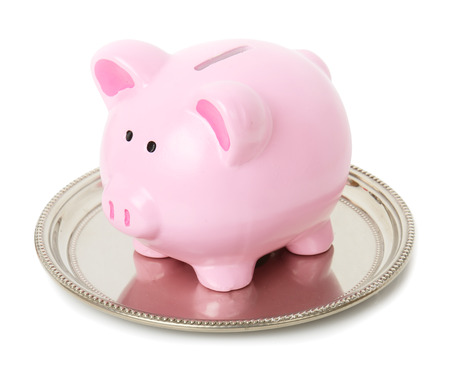 sliver: Piggy bank sat on a sliver tray isolate don a white background