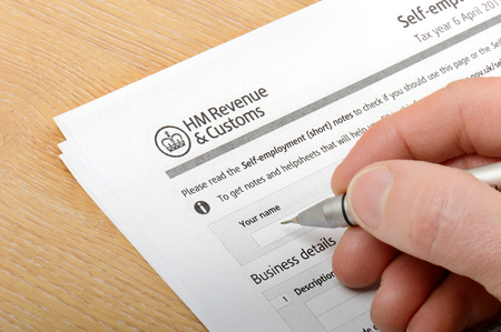 filling in a HM customs form Stock Photo