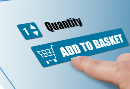 basket: Customer adding to basket on line shopping Stock Photo