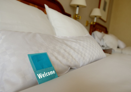 color photographs: a welcome note in a hotel room Stock Photo