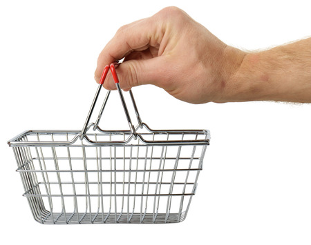 hand basket: hand holding a small shopping basket isolated on a white background Stock Photo