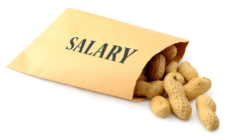 Peanuts falling out of an envelope marked salary isolated on a white background Imagens